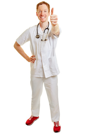 Doctor as a winner holding thumbs up smiling content