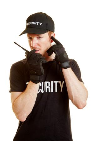 security man: Segurity man alerts his team via radio with security clothes