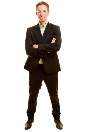 full shot: Businessman standing with crossed arms on a white background
