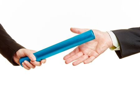 relay race: Handover of the baton in a relay race between two business people