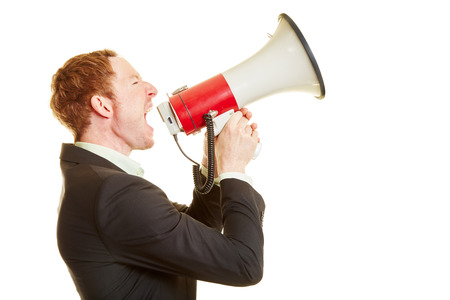 speaking tube: Businessman holding a megaphone and screaming and motivating people