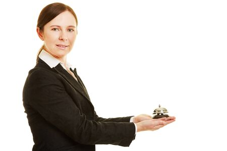 hospitality staff: Female concierge holding a hotel bell in her hands
