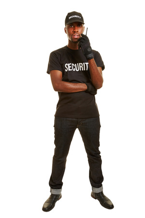 body guard: Full body short of black man as security guard with headset Stock Photo
