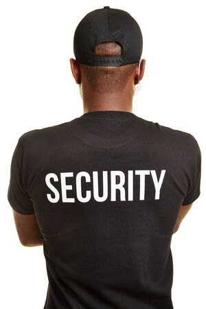 Back of doorman with security shirt and headset Stockfoto