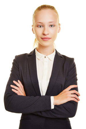 apprenticeship employee: Young business woman looking serious with her arms crossed