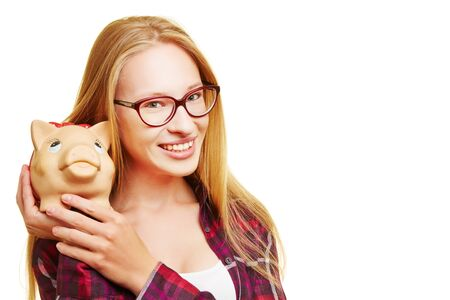 thrift box: Young blonde happy woman holding her piggy bank