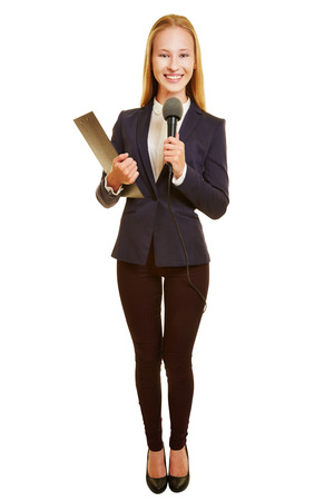 Smiling young woman as reporter with microphone and clipboard