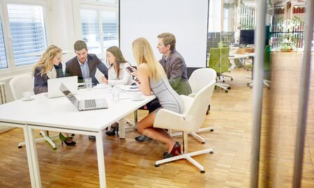 team cooperation: Teamwork and cooperation of a business team in a conference Stock Photo
