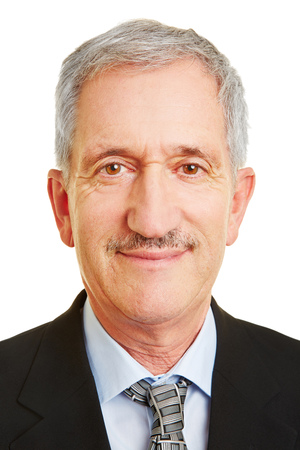 face shot: Frontal face of old smiling businessman for business head shot