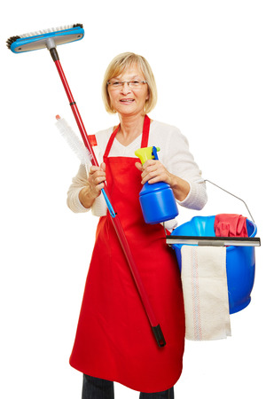 spring cleaning: Housewife doing spring cleaning with many cleaning supplies in her hands