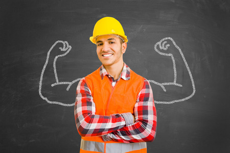 self assurance: Self-confident construction worker in front of chalkboard with muscles drawn with chalk