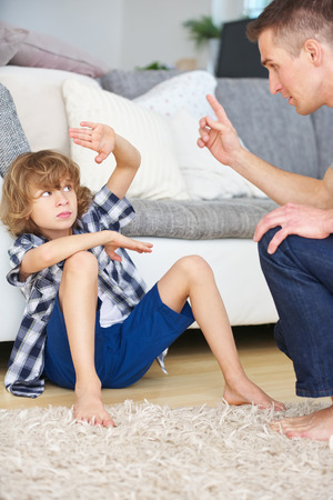 disobedience: Father and son arguing at home and making gestures