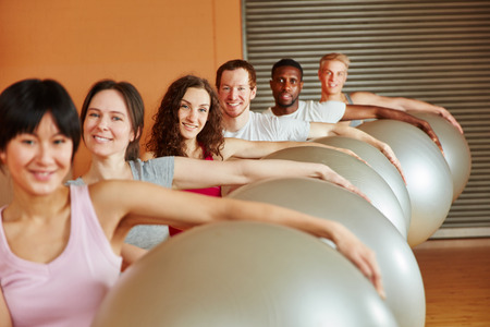 gym ball: Interracial group with gym ball at the gym Stock Photo