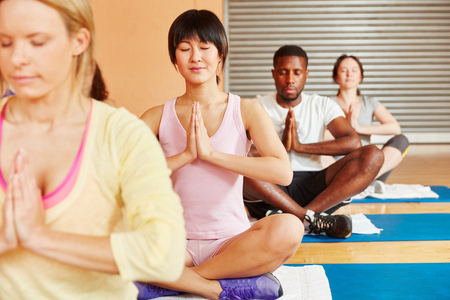 breathing exercise: People meditating in yoga class during a breathing exercise