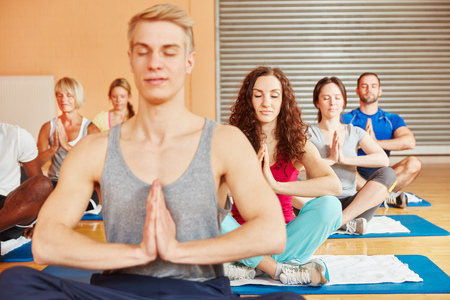 breathing exercise: People making breathing exercise during yoga class at fitness center Stock Photo