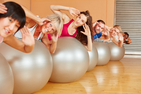 gym ball: Senior citiyen and people working out with gym ball at pilates class