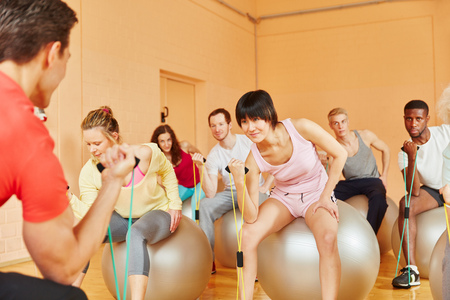 expanding: Pilates class training with expanding band at the gym
