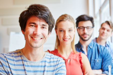 founder: Successful start-up team with differnt students Stock Photo