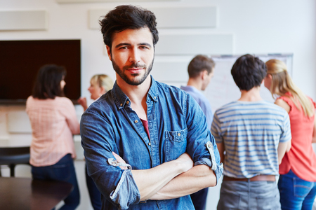 founder: Man as successful student in seminar with arms crossed Stock Photo