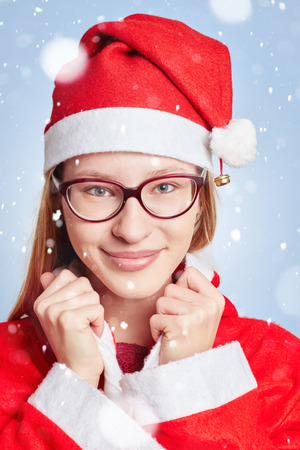 christkind: Young woman dressed like Santa Claus in the snow for christmas Stock Photo