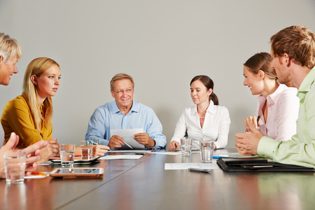 buisiness: Buisiness team with CEO talking in a meeting in a conference room