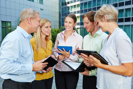 Business team working outside the office with a tablet computer photo