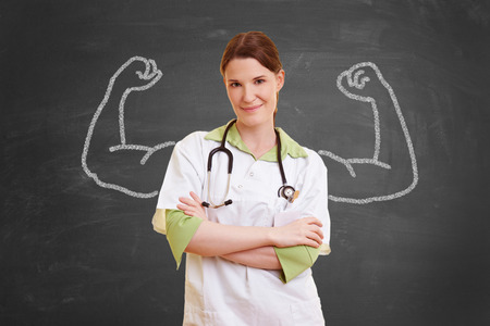 Self confident nurse woman with chalk muscles