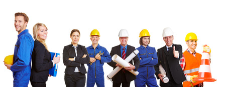 Successful builders team with ingenieurs and workers photo