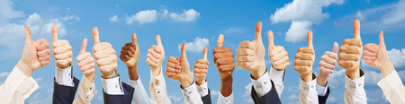 likeable: Many successful hands with thumbs up outside