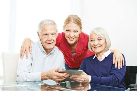 using tablet: Family with senior couple and tablet computer using the internet