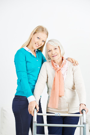 eldercare: Granddaughter helping old senior woman at home