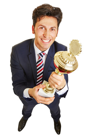 Successful manager smiling with a trophy cup in his hands Stock Photo