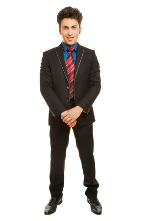 Successful business man as full body shot in front view isolated on a white background Stock Photo