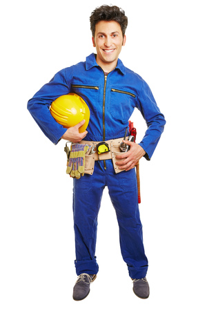 blue overall: Worker with hardhat and blue overall and tool belt isolated on white background Stock Photo