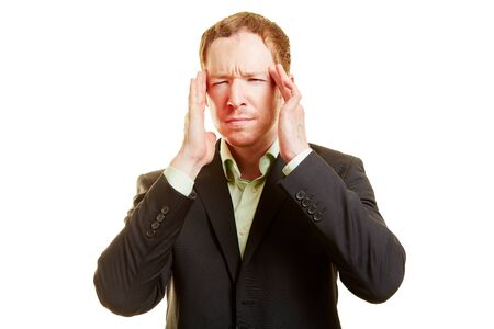 speculate: Man with migraine holding his hands on his temples and looking frustrated