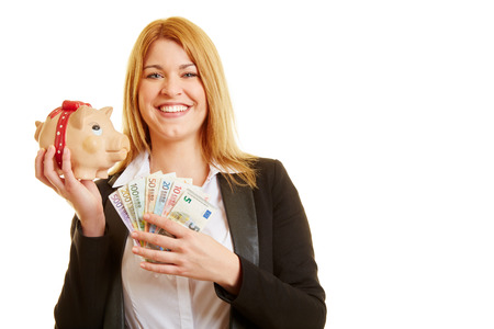 Content woman with money and piggy bank smiling Stock Photo