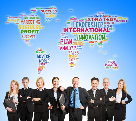 International corporate team and world map with business word concepts photo