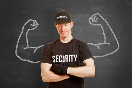 self assurance: Strong and self confident security man with muscles made of chalk Stock Photo