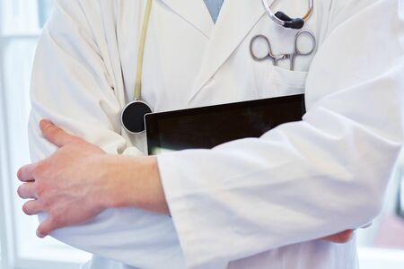 auscultate: Doctor with tablet and medical instruments