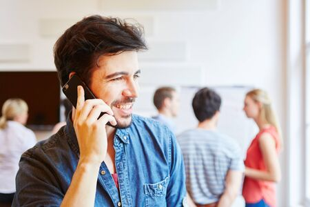hear business call: Man as businessman calling with smartphone Stock Photo