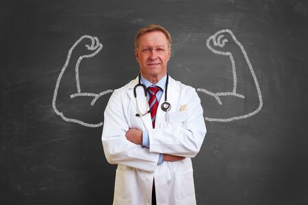 Strong successful doctor concept with muscles made with chalk on blackboard photo