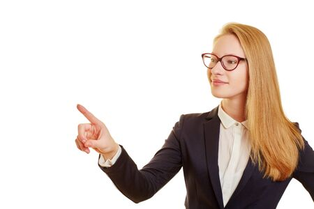 forefinger: Blond businesswoman lifts forefinger for contact with invisible touchscreen Stock Photo