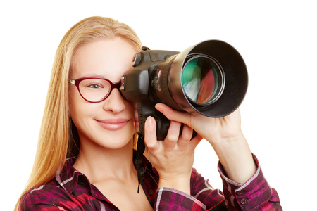 photojournalist: Young woman with glasses as photographer taking pictures with digital camera Stock Photo