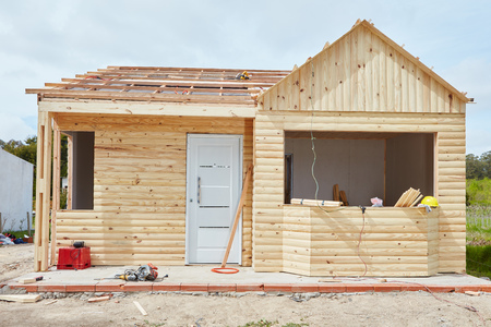 housebuilding: Construction site with woodhouse in construction as garden house
