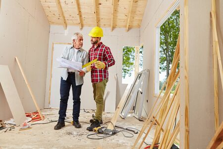 foreman: Architect and foreman working during meeting for building construction Stock Photo
