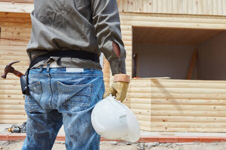 housebuilding: Man as black worker at construction site Stock Photo