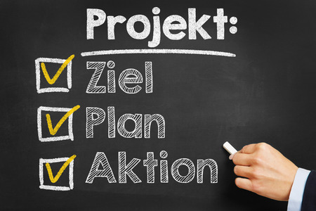 projekt: Hand writing in German Projekt: Ziel Plan Aktion (project: goal plan action) on a chalkboard Stock Photo