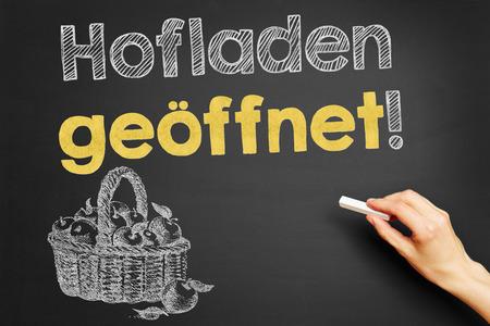 farm shop: Hand writes in German Hofladen geoeffnet! (Farm shop open!) on blackboard Stock Photo