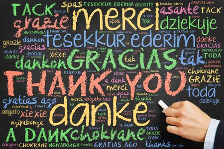 many thanks: Hand writing Thank you in many languages on a chalkboard Stock Photo