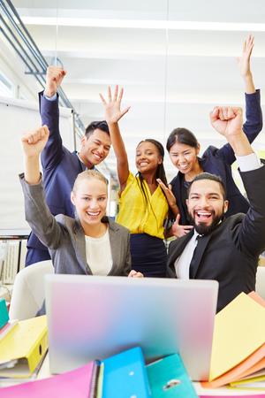 Start-up team celebrating success as a winner team